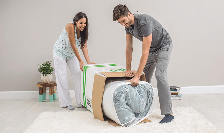 couple is unpacking ghostbed