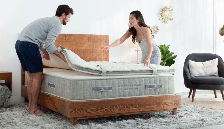 Product image of Brentwood Home bed showing a couple putting the top