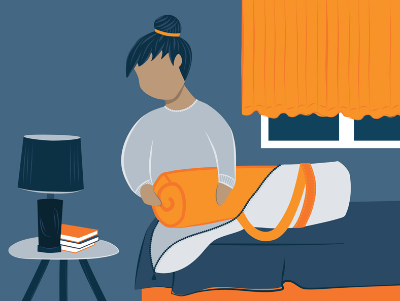 Illustration of a woman folding the mattress topper in the storage bag